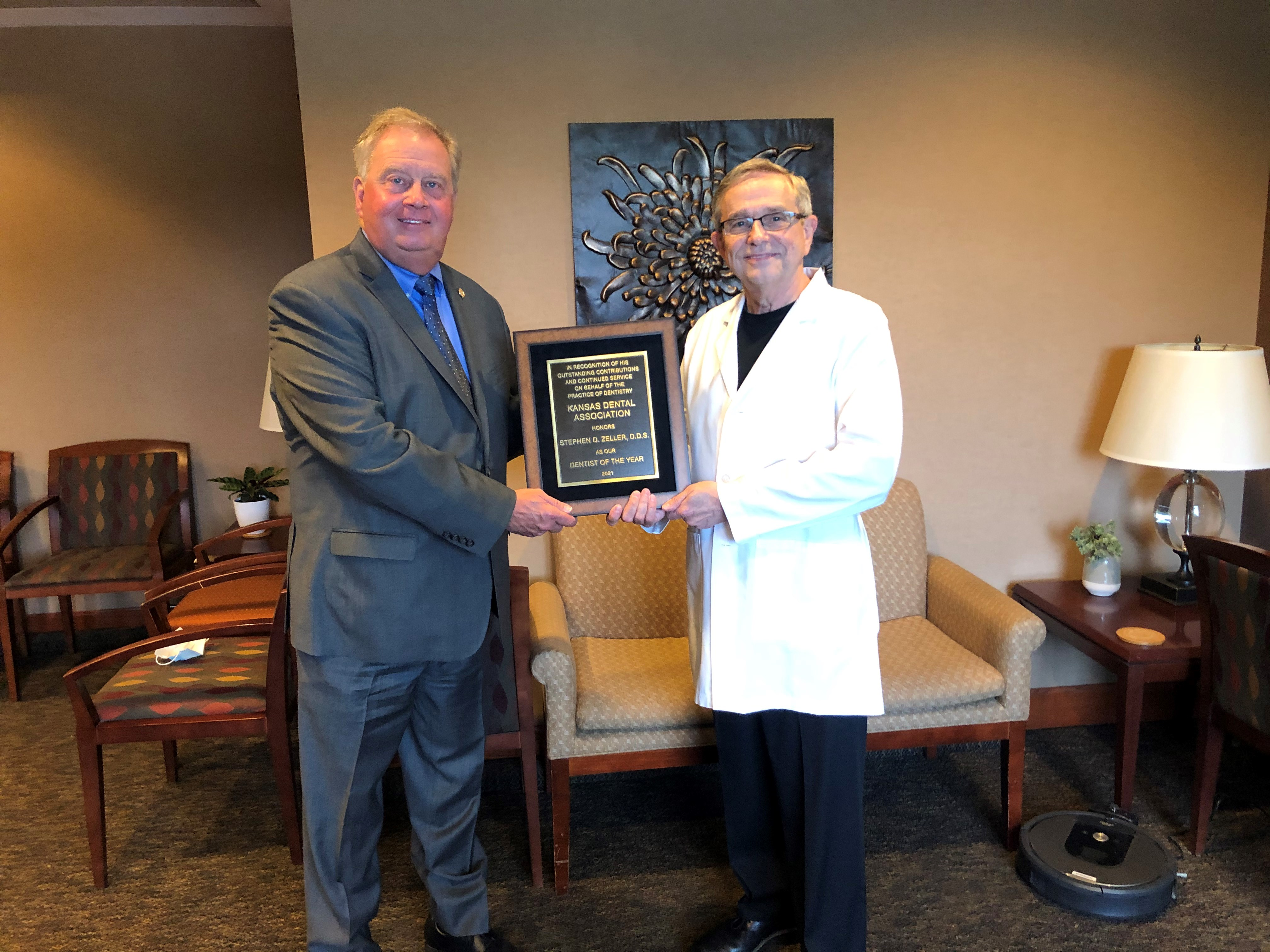 Dr. Reavis and Dr. Zeller with 2021 Dentist of the Year Plaque